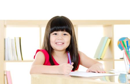 intelligently: Asian girl writing