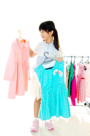 little fashion girl choosing clothes photo