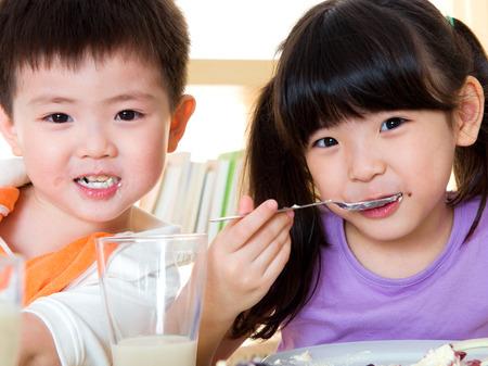Asian kids eating photo
