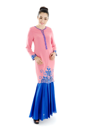 Beautiful muslim woman in elegant traditional dress, baju kurung