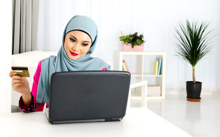 Muslim woman online shopping photo
