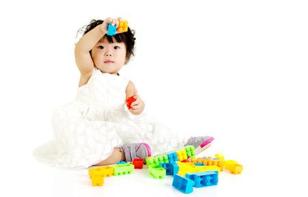Baby girl playing building blocks