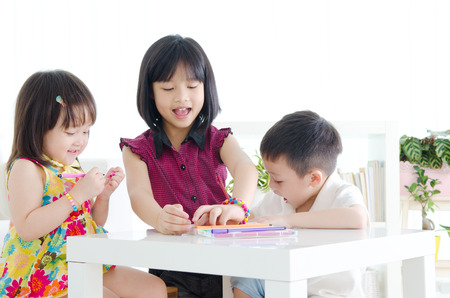 kids drawing with colored pencil Standard-Bild