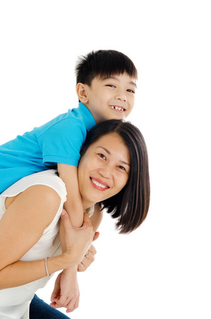 Asian mother piggyback her son Stock Photo