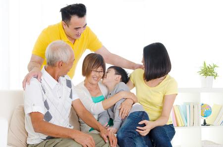 Asian three generations family  Grandchild kiss grandmother  photo