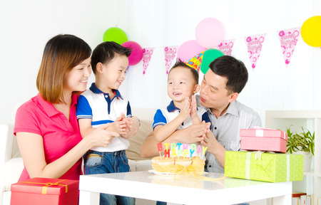 Asian family celebrating birthday photo