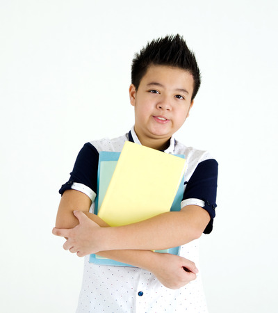 thai student: Portrait of asian student standing and holding books Stock Photo
