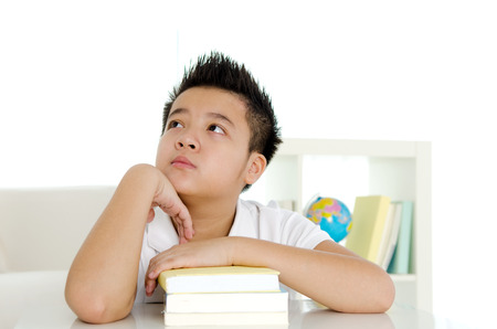 intelligently: Asian student having a thought Stock Photo