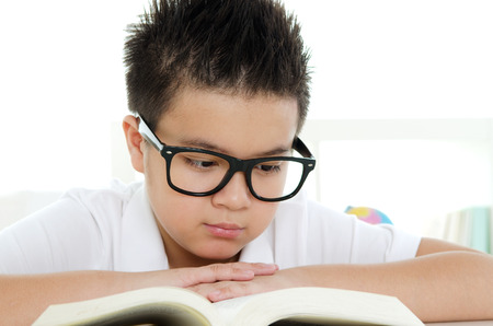 thai student: Asian boy reading a book Stock Photo