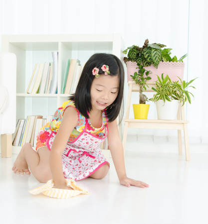 the responsibility: Little girl cleaning up