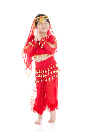 indian saree: Little girl in traditional indian costume, saree and dancing