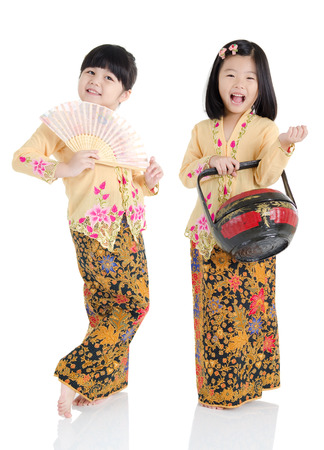 little girls in southeast asian traditional costume