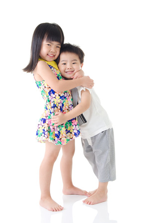 two girls hugging: Lovely asian kids