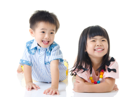 Asian kids lying on the floor and laugh