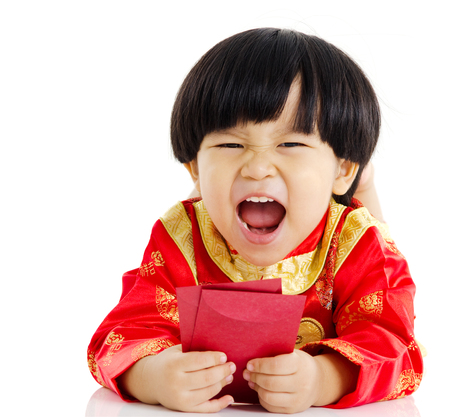 red packet: Asian boy holding a red packet and lying on the floor