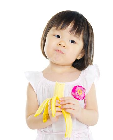 japanese children: Little asian girl eating banana