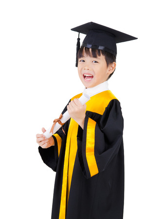 graduates: Cheerful asian boy in graduation gown and mortarboard Stock Photo