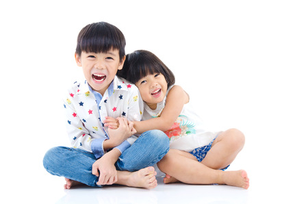 sit studio: Asian kids sitting on the floor Stock Photo