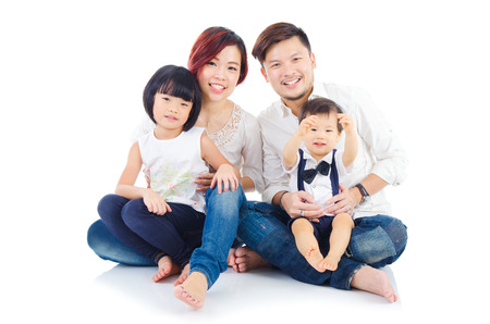 asian child: Indoor portrait of asian family Stock Photo