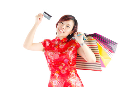 Asian woman showed off her credit card and carrying shopping bags. Credit card shopping concept. photo