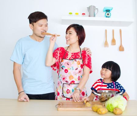 japanese cooking: Asian family in the kitchen Stock Photo
