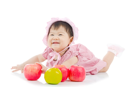 asian baby girl: Cute asian baby girl with apples
