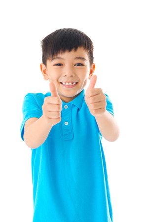 Asian boy raised his thumbs up