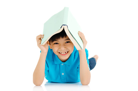 naughty boy: Asian boy covered his head with book Stock Photo