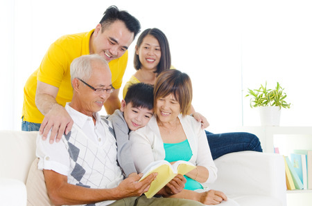 grandmother mother daughter: Asian three generations family reading at home