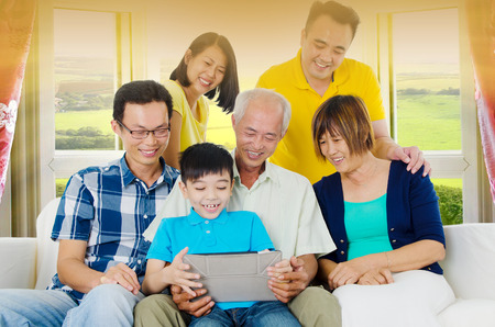 malaysian people: Asian three generations family having fun with tablet computer. Stock Photo