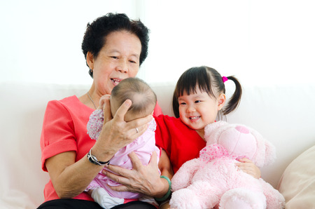 three generations of women: Asian senior woman and her grandchildren