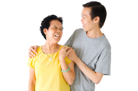 adults offspring: Asian senior woman talking to her son Stock Photo