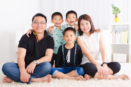 family of five: Asian family in the living room