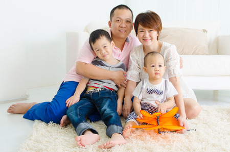 family in living room: Asian family Stock Photo