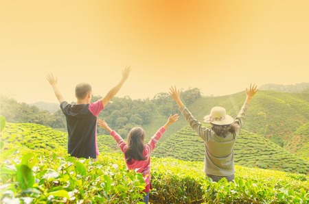 japanese tea garden: Asian family open arms enjoying the beautiful sunset Stock Photo