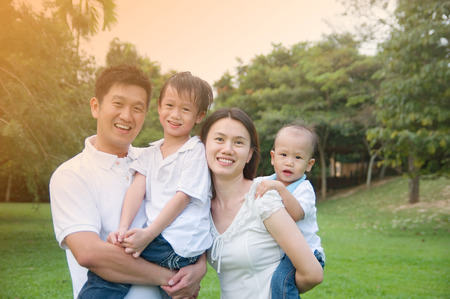 happy asian family: Asian family Stock Photo