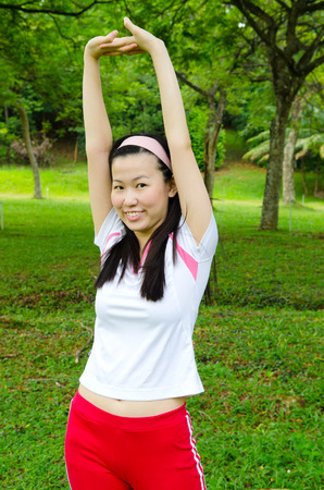 woman stretching: Young asian woman stretching her hands Stock Photo