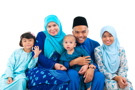 hari raya aidilfitri: Portrait of a cheerful malay family Stock Photo