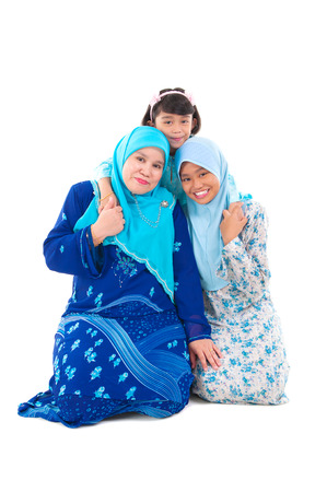 girl bonding: Portrait of malay mother and daughters Stock Photo