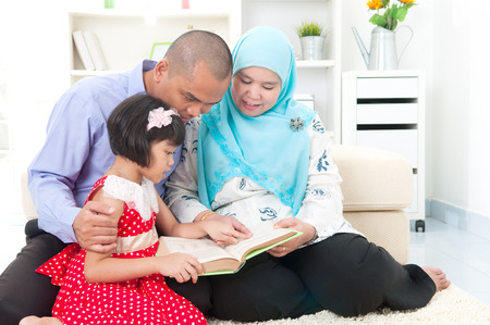 family indoors: Malay family reading Stock Photo