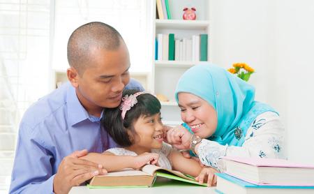 malay family reading Stock Photo