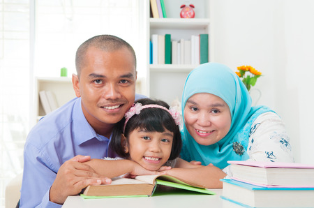 indonesian girl: malay family reading