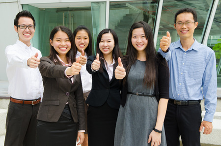 asian group: Asian business team raised their thumbs up