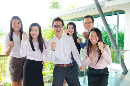 overjoyed: Asian business team overjoyed on their success
