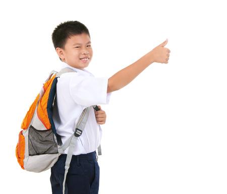 Asian primary school boy raised his thumb up
