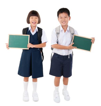 Asian school kids holding chalk board Standard-Bild