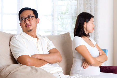 sad couple: A pregnant woman quarrelled with her husband Stock Photo