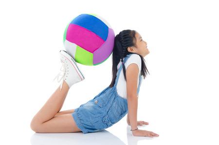 asian children: Asian girl doing exercise using a balance ballo
