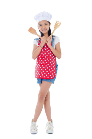 thai girl: Asian girl wearing apron and holding cooking utensil
