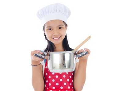 asian chef: Asian girl wearing apron and holding a cooking pot Stock Photo